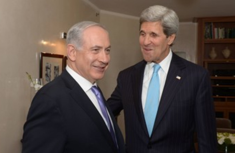 kerry meeting with netanyahu both smiling 370 (photo credit: GPO/Amos Ben Gershom)