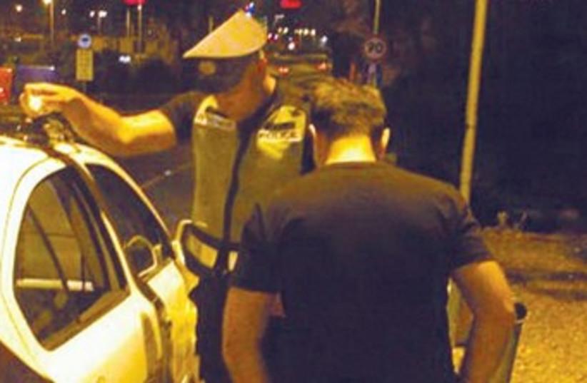 A traffic officer checks a driver in Tel Aviv 370 (photo credit: Ben Hartman)