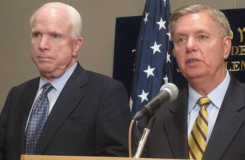 US SENATORS John McCain and Lindsey Graham address a news co (photo credit: STEVE LINDE)