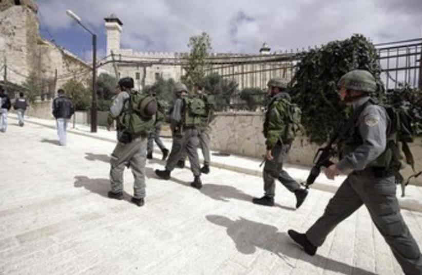 Israeli Border Police at the Cave of the Patriarchs 370 (photo credit: Reuters)