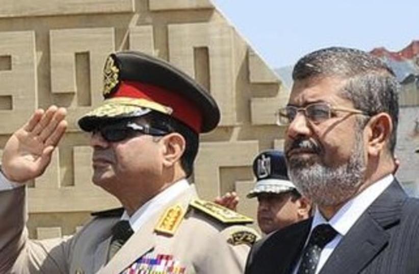General Abdel Fattah al-Sisi and Morsi370 (photo credit: Reuters)