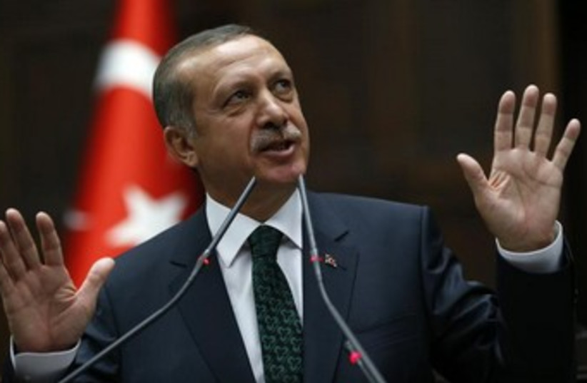 Erdogan jazz hands 370 (photo credit: REUTERS)