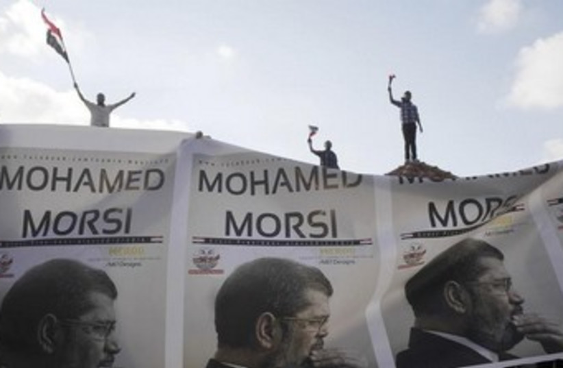 muslim brotherhood - morsi banners 370 (photo credit: REUTERS)