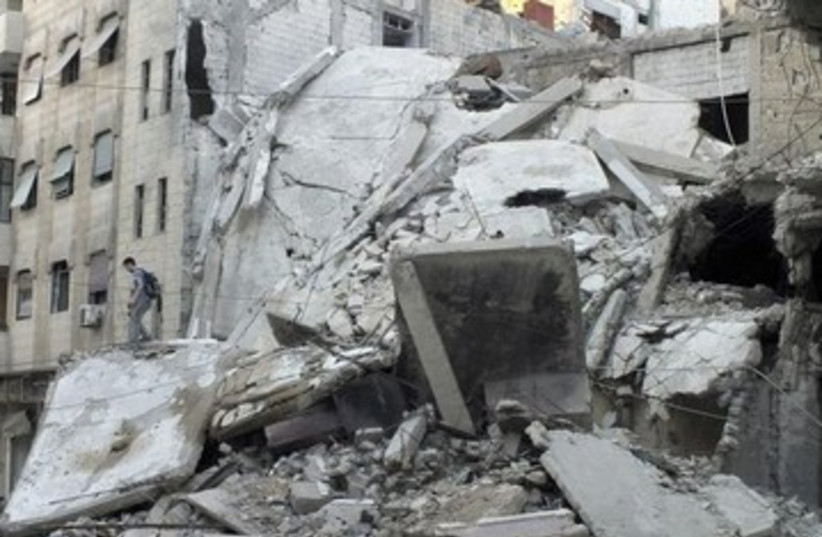 Damage from fighting in Syria's Homs 370 (photo credit: REUTERS)