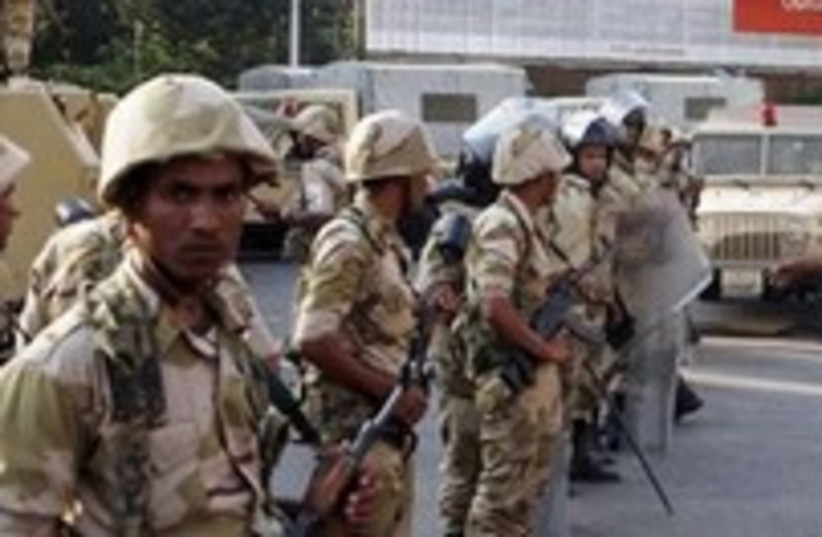 Egyptian army stands guard near Morsi supporters300 (photo credit: REUTERS)