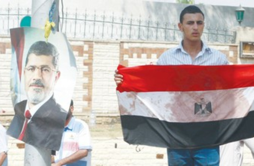 An Egyptian supporter of Mohamed Morsi 370 (photo credit: Reuters)