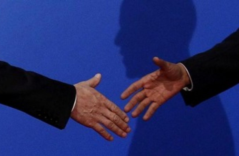 handshake 370 (photo credit: REUTERS)