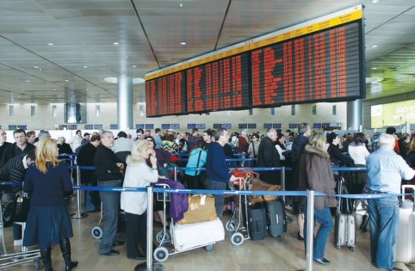 TRAVELERS WAIT in line at Ben-Gurion International Airport. Let critics come to Israel and see this country's success and vibrancy for themselves. (photo credit: RONEN ZVULUN/REUTERS)