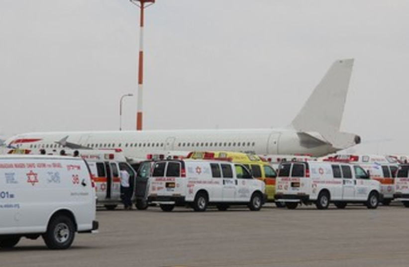 Plane at Ben Gurion emergency370 (photo credit: Magen David Adom, Courtesy)