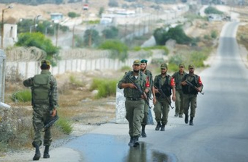 Palestinian troops loyal to Hamas on patrol 370 (photo credit: REUTERS)
