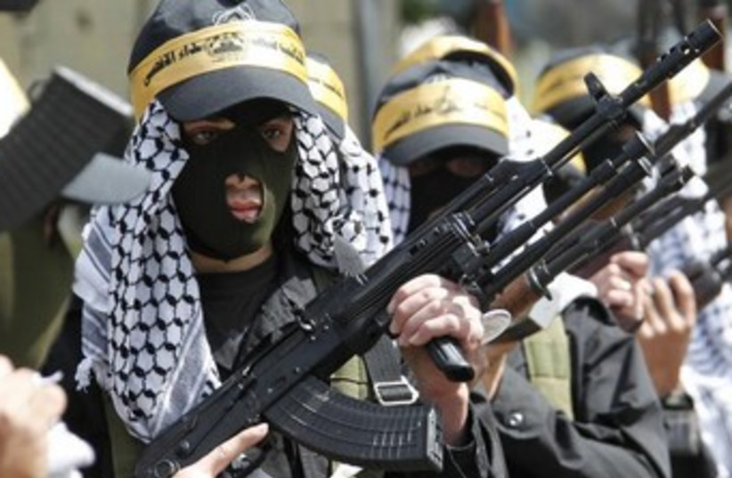 fatah gunment 370 (photo credit: REUTERS)