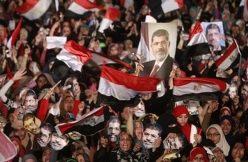 Morsi supporters demonstrate 370 (photo credit: REUTERS)