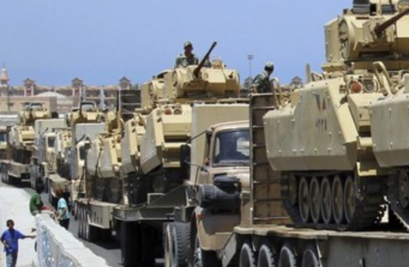 Egyptian army tanks en route to Rafah 370 (photo credit: REUTERS/Mohamed Abd El Ghany)