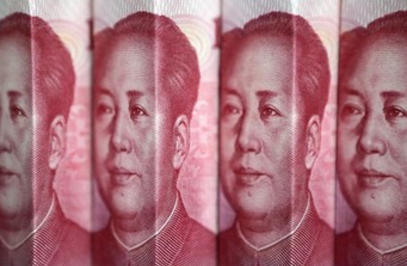 China (yen)  (photo credit: REUTERS/Jason Lee)