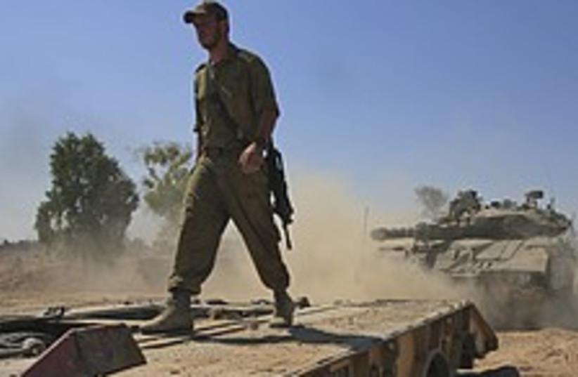 Soldier walks on tank  (photo credit: AP)