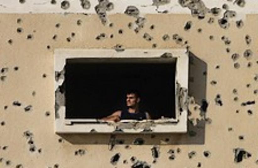 Gaza bullet-riddled home (photo credit: AP)