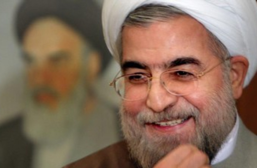 Hassan Rouhani lauging370 (photo credit: REUTERS/Raheb Homavandi)