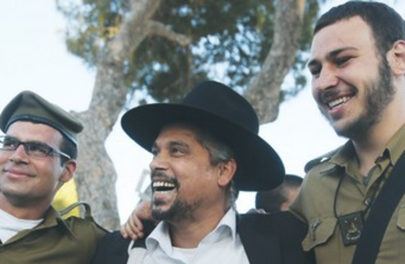 MAN CELEBRATES with soldiers from the Kfir Brigade 370 (photo credit: Marc Israel Sellem/The Jerusalem Post)