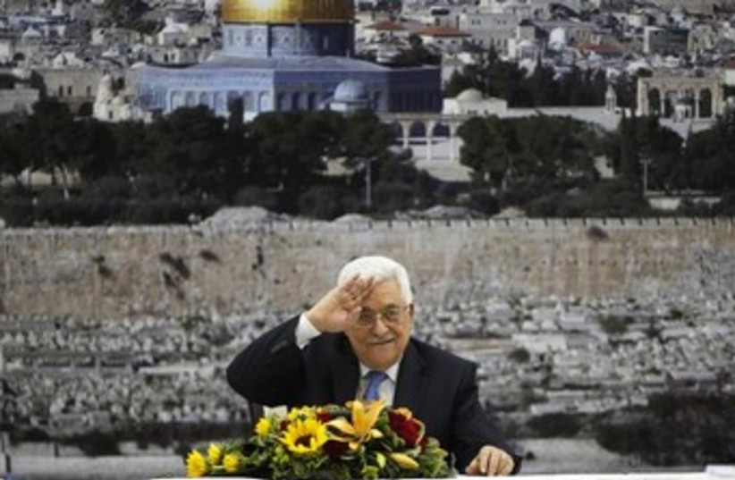 Abbas with a Jerusalem background 370 (photo credit: REUTERS/Mohamad Torokman)