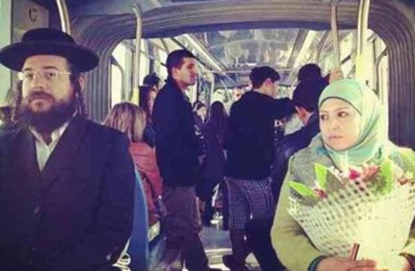 Arab woman haredi man on light rail 370 (photo credit: Shalom Hartman Institute)