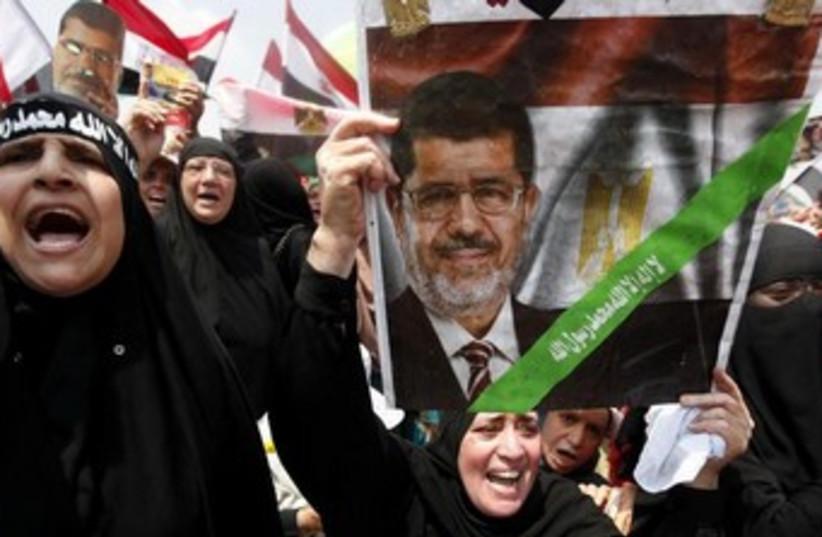 Pro-Morsi demonstrators in Cairo 370 (photo credit: REUTERS)