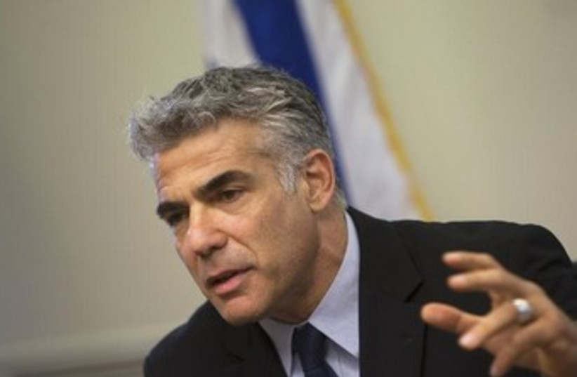 Finance Minister Yair Lapid 370 (photo credit: REUTERS)