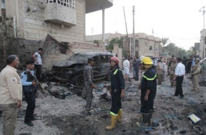 Carbombing attack in Iraq 370 (photo credit: REUTERS)
