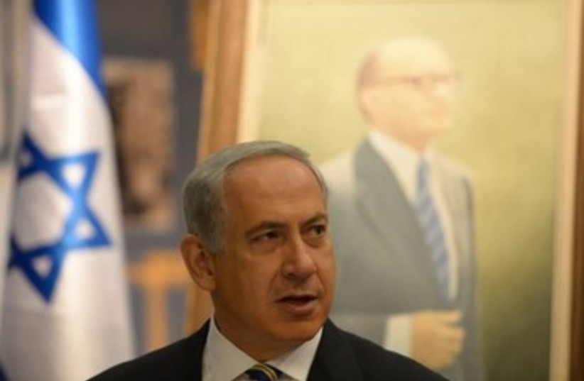 Netanyahu with Begin picture in background 370 (photo credit: courtesy Prime Minister's Office)