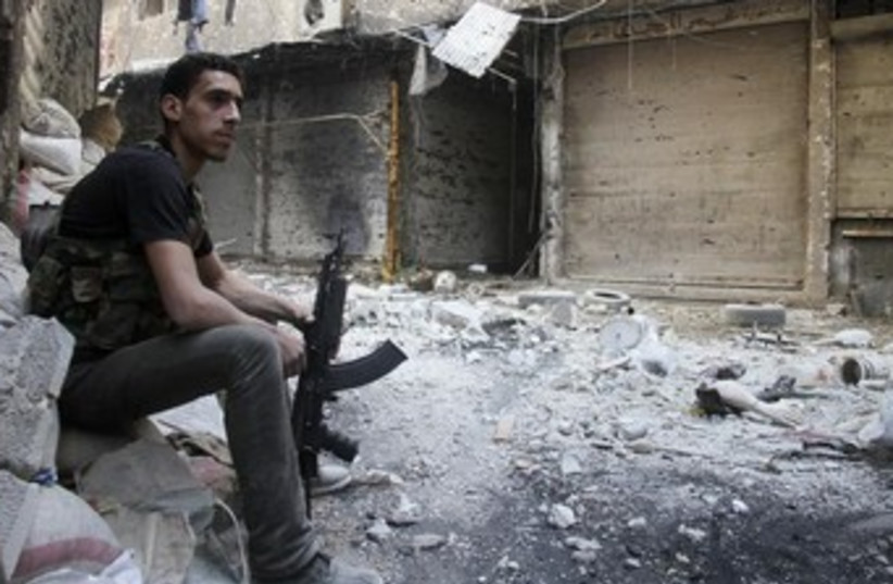 A Free Syrian Army fighter in Yarmouk refugee camp 370 (photo credit: REUTERS)