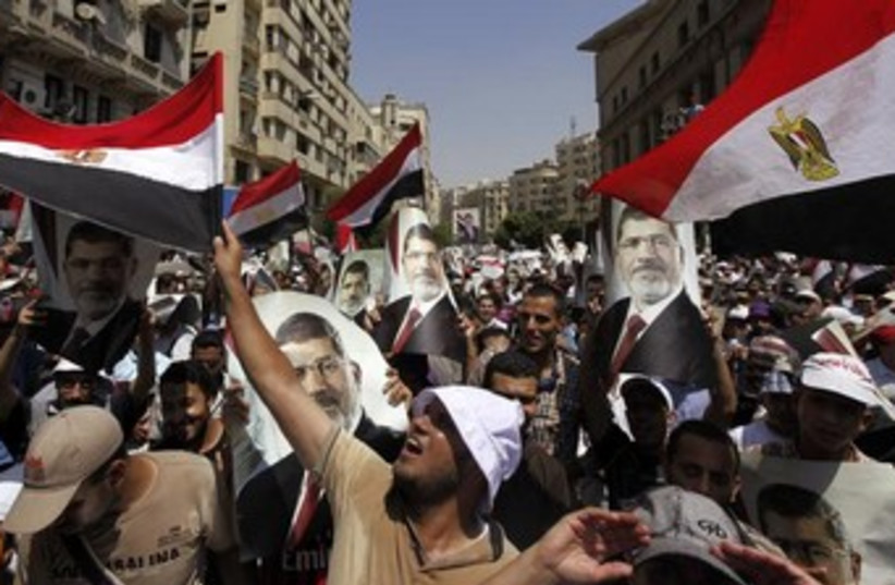Morsi supporters with flags 370 (photo credit: REUTERS)