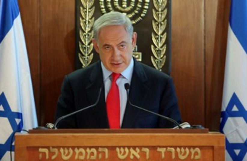 Netanyahu looking coy 370 (photo credit: Marc Israel Sellem/The Jerusalem Post)
