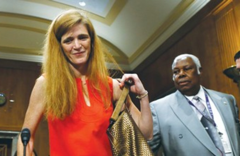 Samantha power in red dress 370 (photo credit: REUTERS)