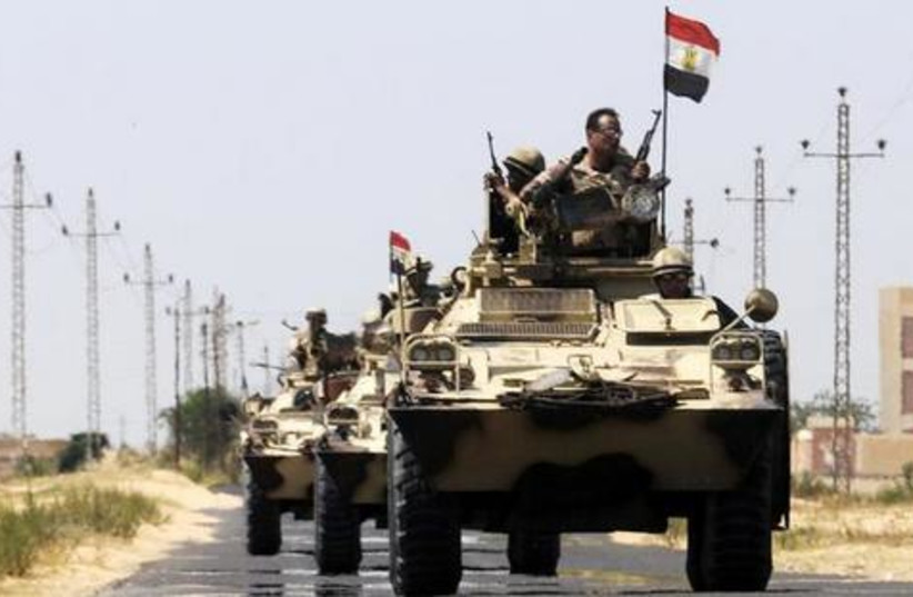 Egyptian soldiers move into El Arish, northern Sinai (photo credit: Reuters)