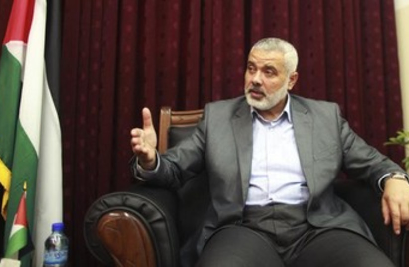 Ismail Haniyeh on a chair, looking expressive 370 (photo credit: REUTERS)