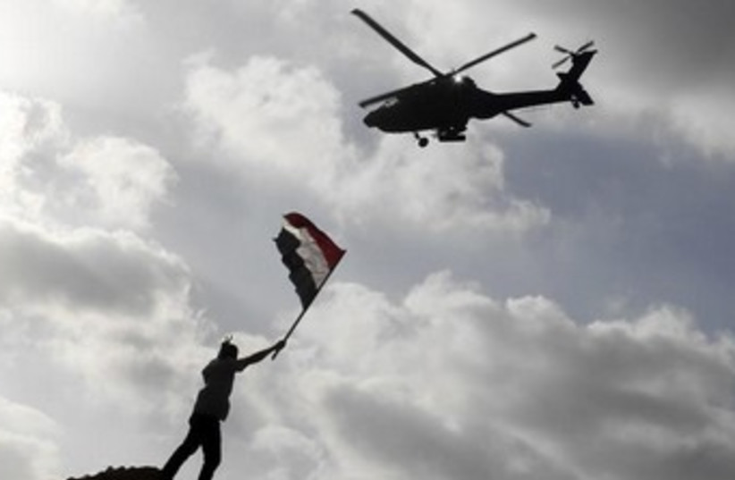 Egyptian army helicopter over Alexandria 370 (photo credit: REUTERS/Asmaa Waguih)
