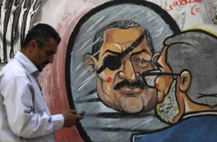 Morsi graffiti in Cairo 370 (photo credit: REUTERS)