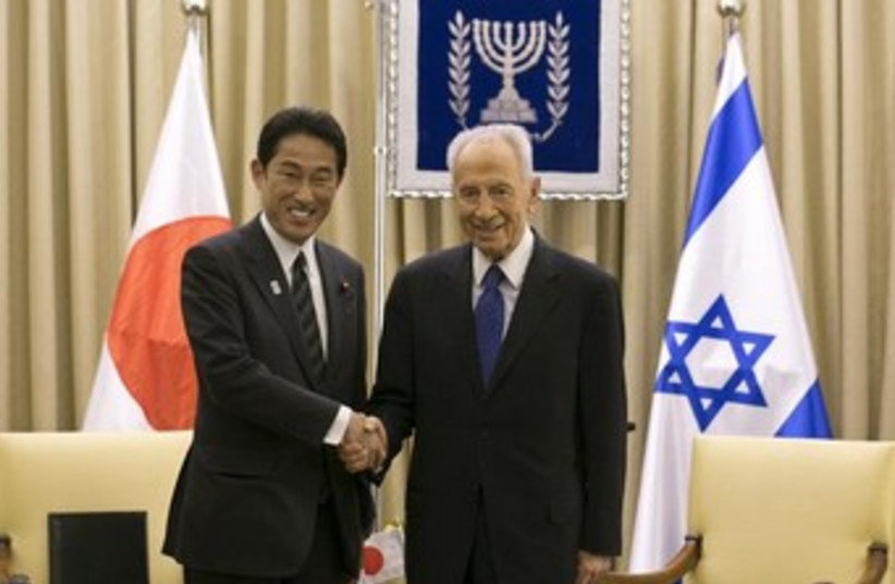 peres with japanese fm 370 (photo credit: REUTERS)