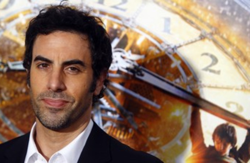 """Actor Sacha Baron Cohen attends the premiere of """"Hugo""""  (photo credit: REUTERS/Eric Thayer)"""