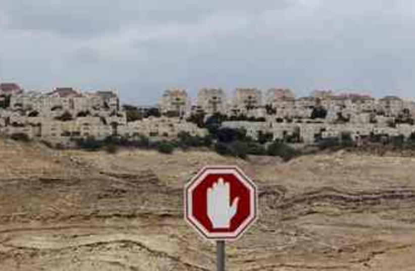 A stop sign is seen outside a West Bank Jewish settlement (photo credit: Reuters)