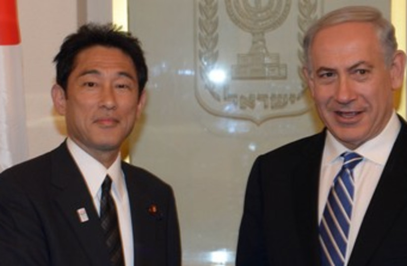 Netanyahu and Japanese Foreign Minister Fumio Kishida 370  (photo credit: GPO / Moshe Milner)
