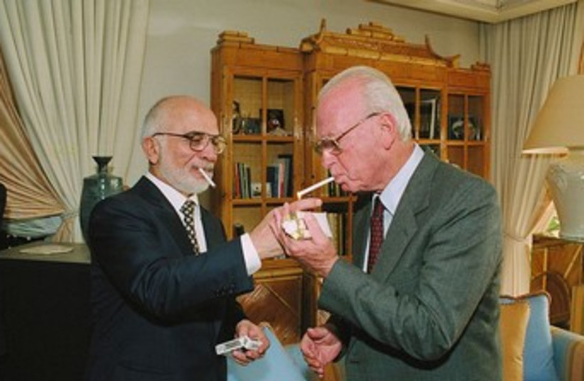 King Hussein, Yitzak Rabin share a ciggie 370 (photo credit: GPO)