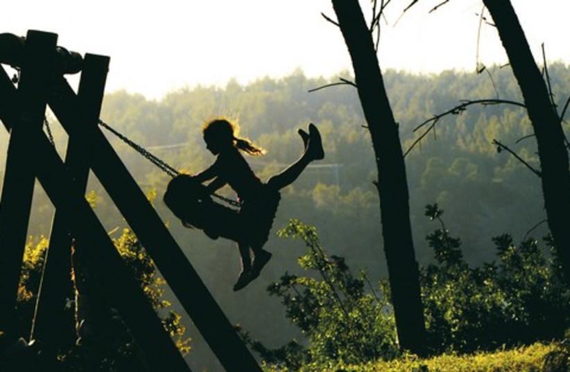 Picture from the Parasha girls swinging 521 (photo credit: Israel Weiss (weisssi@bezeqint.net) http://artfram)