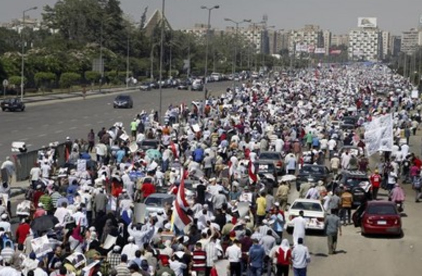 Muslim Brotherhood members and supporters of Mohamed Morsi march in Cairo.
