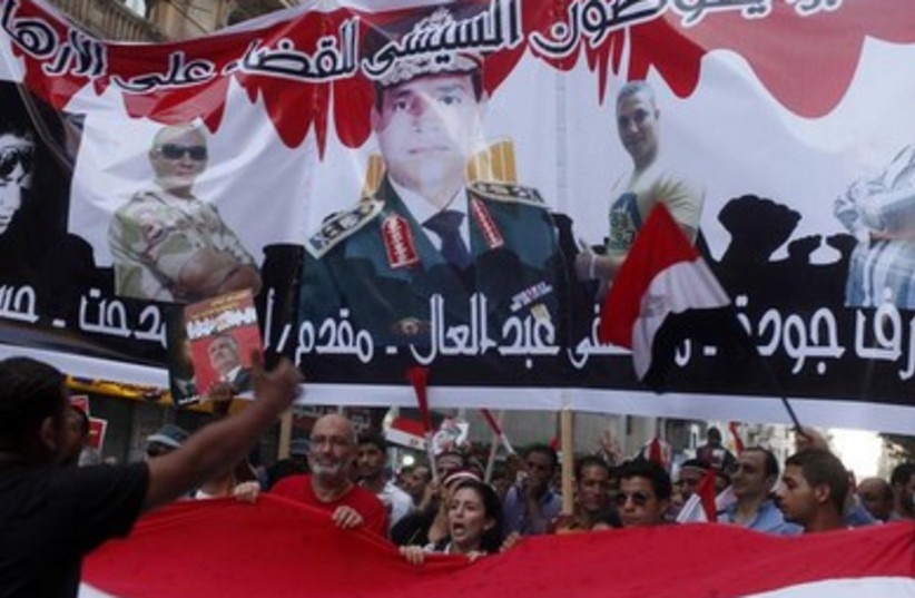 Protesters gather for a mass protest to support the army in Cairo.