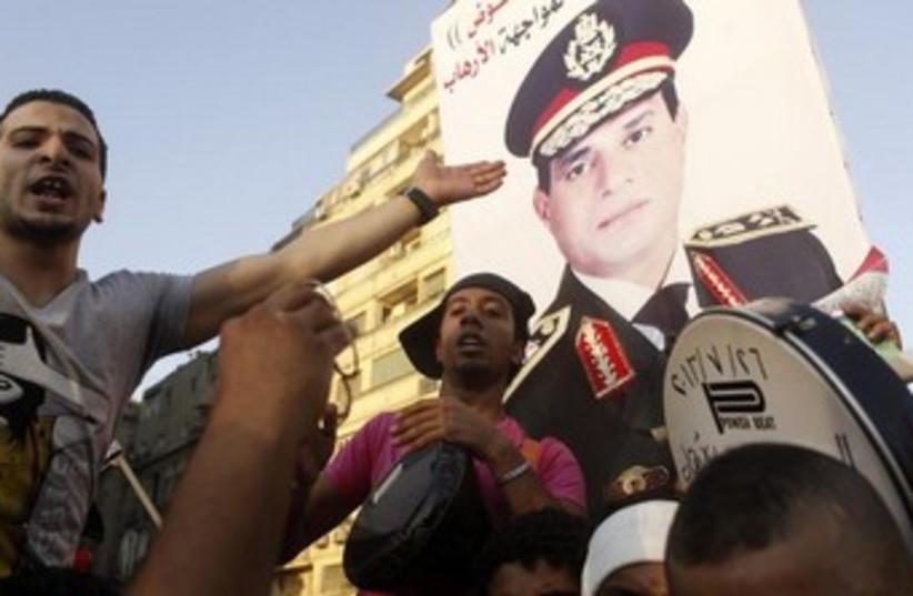 Anti-Morsi protesters with Sisi poster 370 (photo credit: REUTERS/Asmaa Waguih)