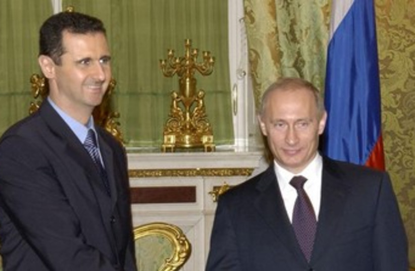 Bashar Assad and Vladimir Putin 370 (photo credit: REUTERS)