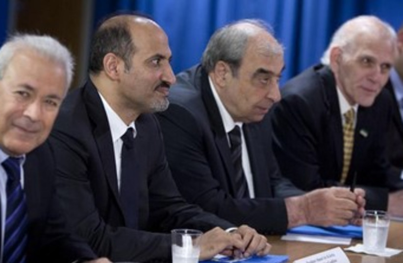 President of Syrian Opposition Coalition 370 (photo credit: REUTERS)