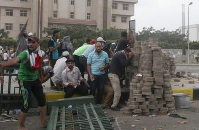 Morsi supporters barricade themselves in Nasr City protest, July 27, 2013.