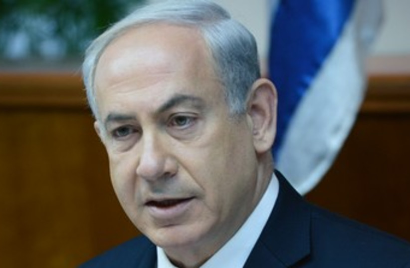 Netanyahu at cabinet meeting 370 (photo credit: Koby Gideon/GPO)