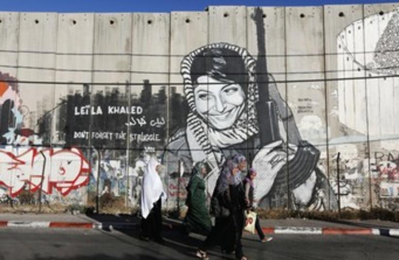 graffiti of freed Palestinian terrorist Leila Khaled 370 (photo credit: REUTERS)
